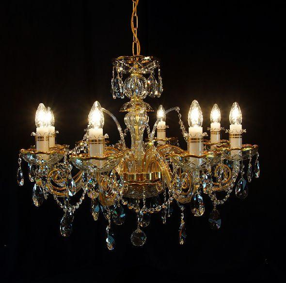 Złoty żyrandol z kryształami Swarovski - ekskluzywna lampa do salonu