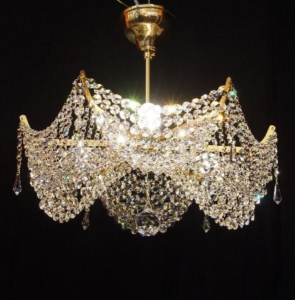 Modna lampa do stylowego apartamentu - żyrandol z kryształami Swarovski