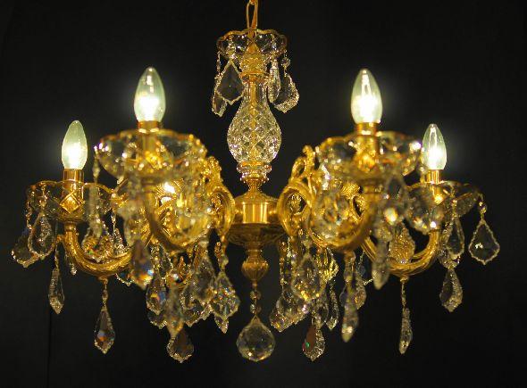 Mosiężna lampa - złoty żyrandol z mosiądzu ozdobiony kryształami